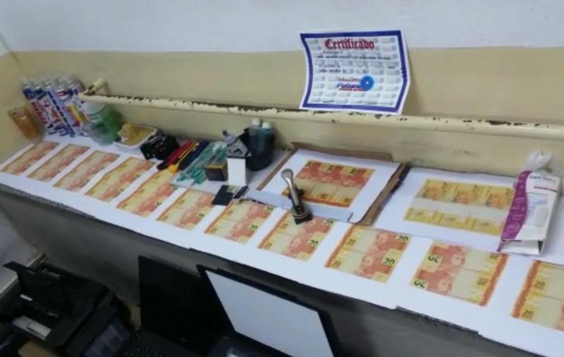 Polícia descobre fábrica de dinheiro falso e apreende R$ 13 mil em ...